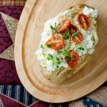 baked potato with ricotta and tomatoes