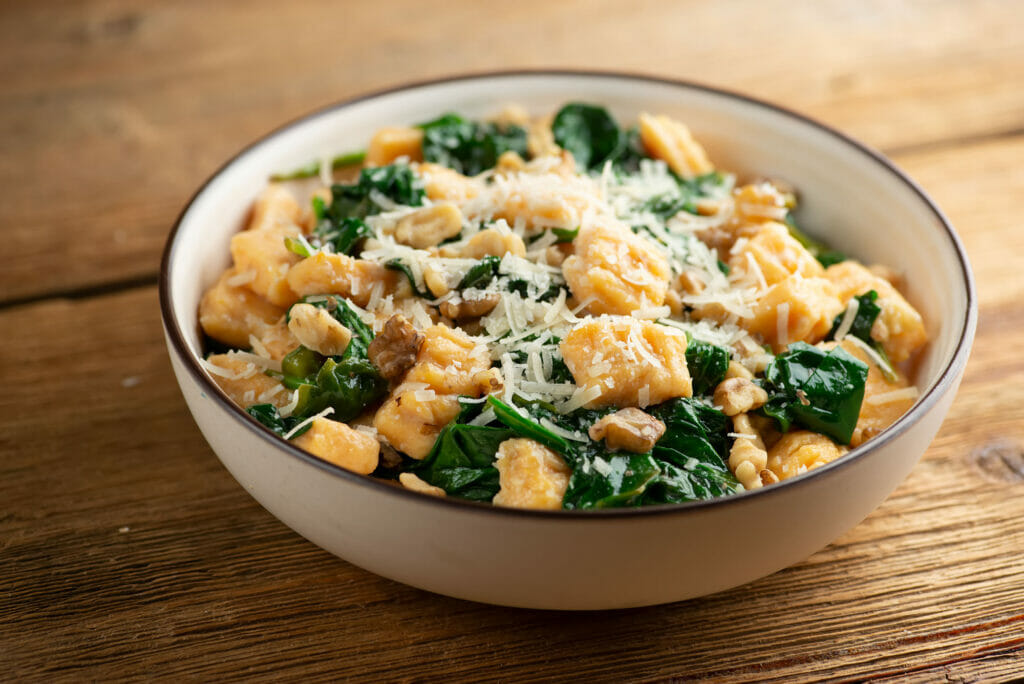 sweet potato gnocchi with spinach and walnuts